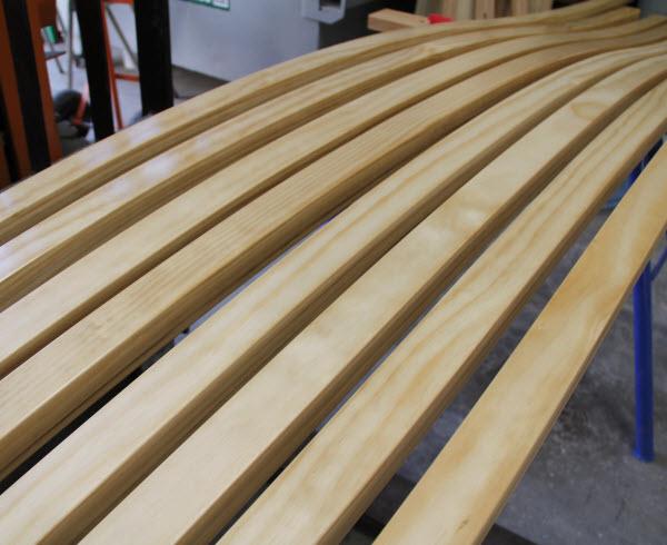 Row of Laminated beams