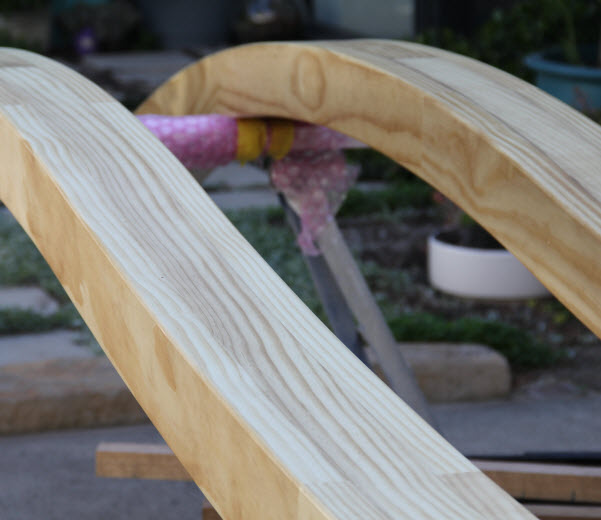 Accoya curved wood placed on a steel stand
