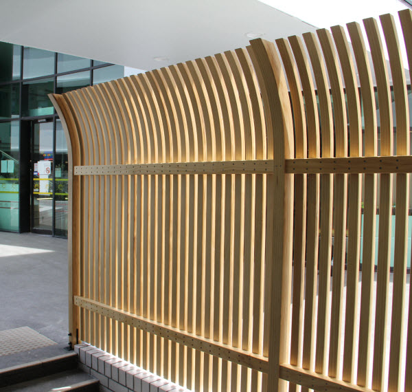 Accoya wood divider placed outside a building